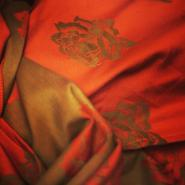 """In Bloom"" Mandarin & Green Jacquard Roses Cotton Baby Wrap"